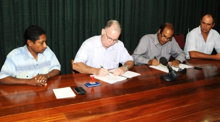 Messrs Morin and Padaruth signing the contract