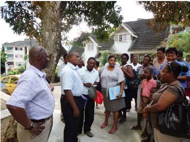 HFC and MLUH officials brief residents on their new apartments in the presence of MNA Fideria (left)