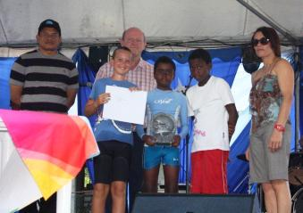 The boys' under-15 title was won by the trio of Ryan Alcindor, Malik Govinden and Bertrand Payet pictured here with Ministers Rolf Payet and Alain St Ange and STB chief executive Grandcourt