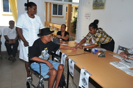 An elderly Seychellois casts her vote. Seychelles is noted as a country where all are able to cast their ballots in free and fair elections