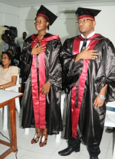 Benilda Cupidon and Garry Jupiter join colleagues around Africa in putting their hand accross their chest as their diplomas are conferred upon them
