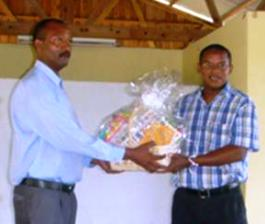 IDC deputy chief executive Ronny Renaud (right) presenting a donation of books to the school