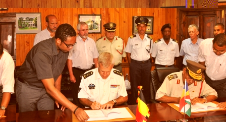 Brigadier Payet (right) and Colonel Derolez signing the agreement