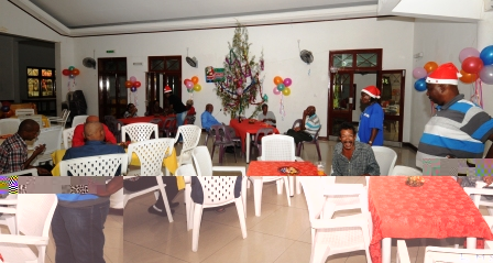 Mr Fideria (standing right) interacting with his guests before lunch