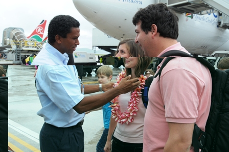Mr Faure welcomes the Swiss couple at the airport yesterday