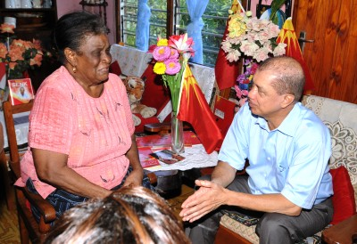President Michel paying a visit to an emotional Eva Charles at Plaisance. During his visit there he also met other elderly residents and inspected a newly completed secondary road