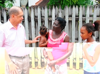 Talking to a resident while touring the Roche Caiman district