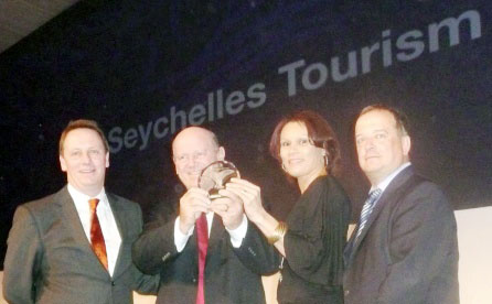 Minister St Ange and chief executive Grandcourt hold the prestigious World Routes 2012 award in recognition of Seychelles' appreciation of the importance of the golden triangular approach of airlines, aviation authorities and tourism boards in moving tourism forward