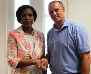 Mrs Nkoana-Mashabane is welcome by Minister Adam