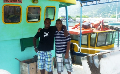 Fisherman Hoareau (right) with his colleague Joel Faure on their boat