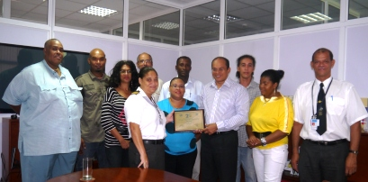 Minister Payet and stakeholders proudly display the award