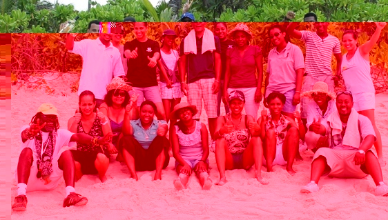 The members in a souvenir photograph on the beach at the end of the team-building day