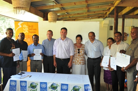 Group photo of guests and representatives of the five NGOs who signed funding accords for their projects under the SGP