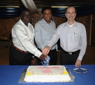 Vice-President Faure, Minister Morgan and Mr Zialor cutting the anniversary cake