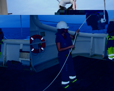 Miss Gendron deploying the long cable attached to the hydrophone, to detect sea mammals in the area
