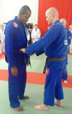Cesar (left) being promoted to purple belt