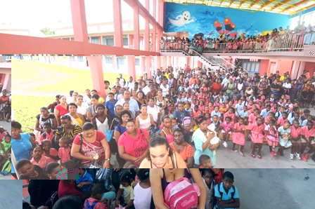 The children and their parents during the school assembly