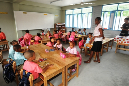 A group of children settling in their new classroom ready to start work