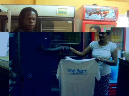 Sonny receiving the T-shirts from Jeannette Confait of Yvon's Bakery