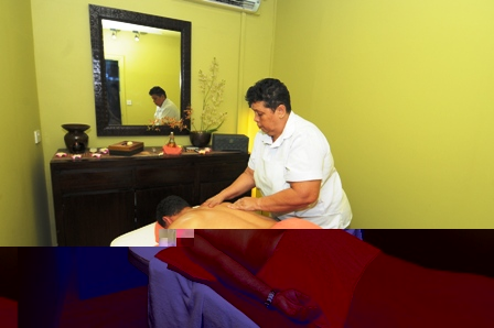 A male client having a body massage: the centre caters for both gender