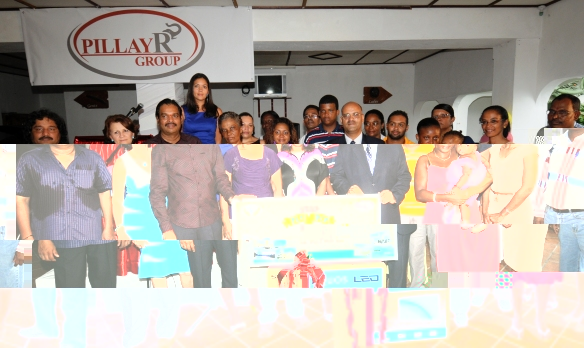 Lucky winners with the CEO, different managers, guests and staff of Pillay R Group