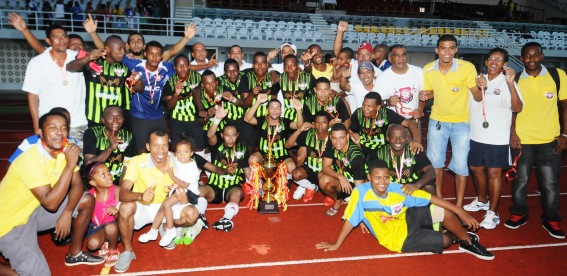 St Michel players celebrate winning a fourth consecutive President's Cup
