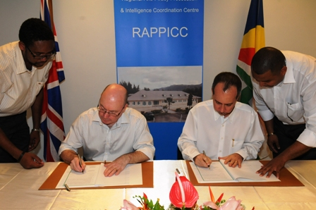 Minister Burt and Minister Morgan signing the operational MoU and partnership agreement between UK and Seychelles
