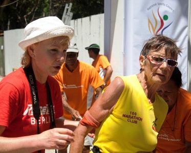 German Sigrid Eichner (centre) after completing her 1,751st marathon