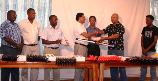 Mr Gopal hands over a sample of the equipment to SHF chairman Valentin in the presence of Socga and SHF officials