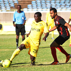 Tusker's Andrew Sekayombwa (left) is defended by St Michel's Allen Larue in Saturday's away fixture in Nairobi