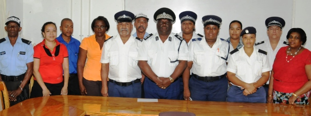 Commissioner Quatre in a souvenir photograph with the officers who had been affected by the disaster