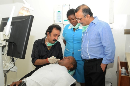 The Indian experts, assisted by a local nurse, attending to a patient