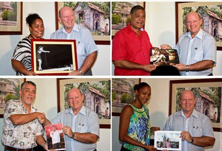 Joenise Juliette, Joe Samy (top left and right), Dereck Savy and Michelle Marengo presenting their snaps to Minister St Ange