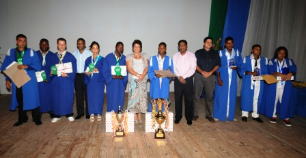 Students who have excelled in their respective courses at both institutions in a souvenir photograph with guests at the ceremony