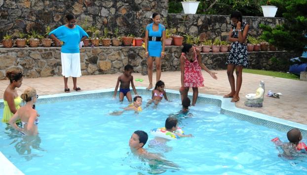 The children having fun in the pool