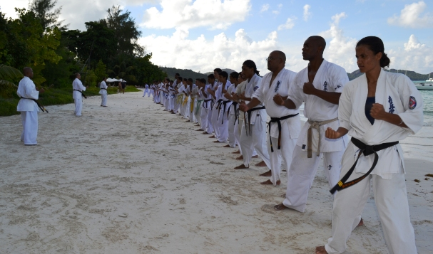 Kyokushin karatekas during a beach training session
