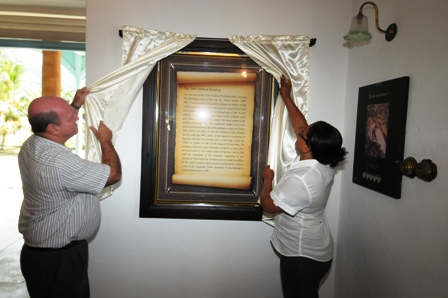 Minister St Ange, accompanied by Creole Institute director Penda Choppy, unveils the information plaque that highlights the institute's importance as a national monument