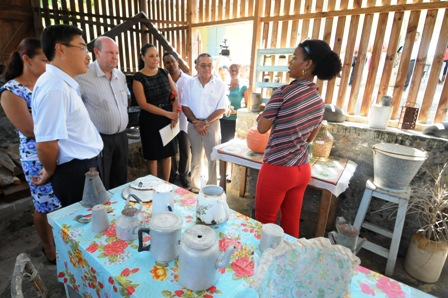 Ms Barbé taking guests on a tour of the traditional outdoor kitchen of the Creole Institute