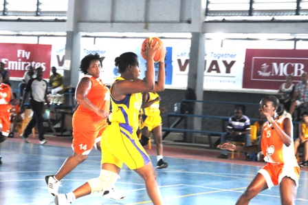 Pictured here against Mont Fleuri, Magdeline Julienne (with ball) scored 15 points in Stars' win against Juniors