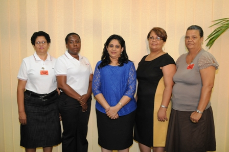 Representatives of STC and the DPA with Mrs Nair and Mrs Servina after they had presented their cheques