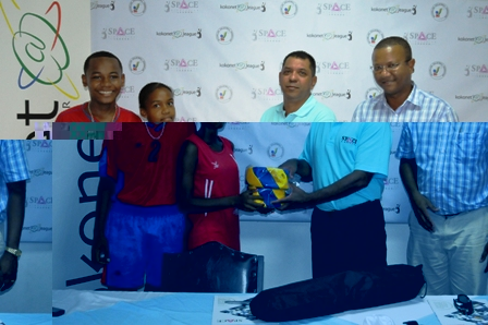 Camilla Francourt presents two volleyballs to Mr Moutia in the presence of SVF chairman Florentine and young player Lance Henry