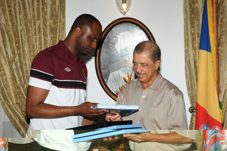 Mr Vieira offering mementoes to President Michel