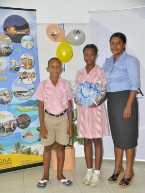 Anse aux Pins students and head teacher with the newly acquired utensils