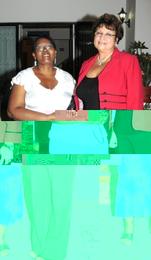 Miss Mena with Education Minister Macsuzy Mondon
