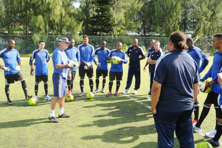 Coach Heredia (third left) giving instructions to the goalkeepers and goalkeeping coaches