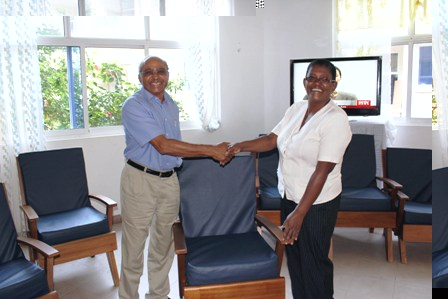 Mr Patel hands over the chairs to Ms Joubert