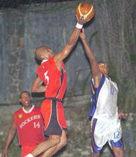 Rocker Cyril Agrippine (left) is challenged by Razor Nigel Cafrine as he drives to the hoop